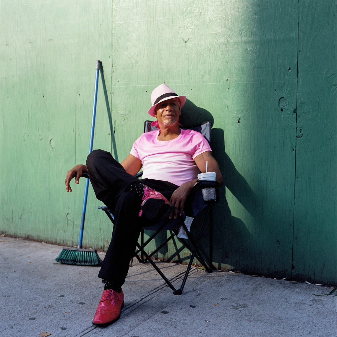 A guy chills out from the summer heat in Harlem NYC