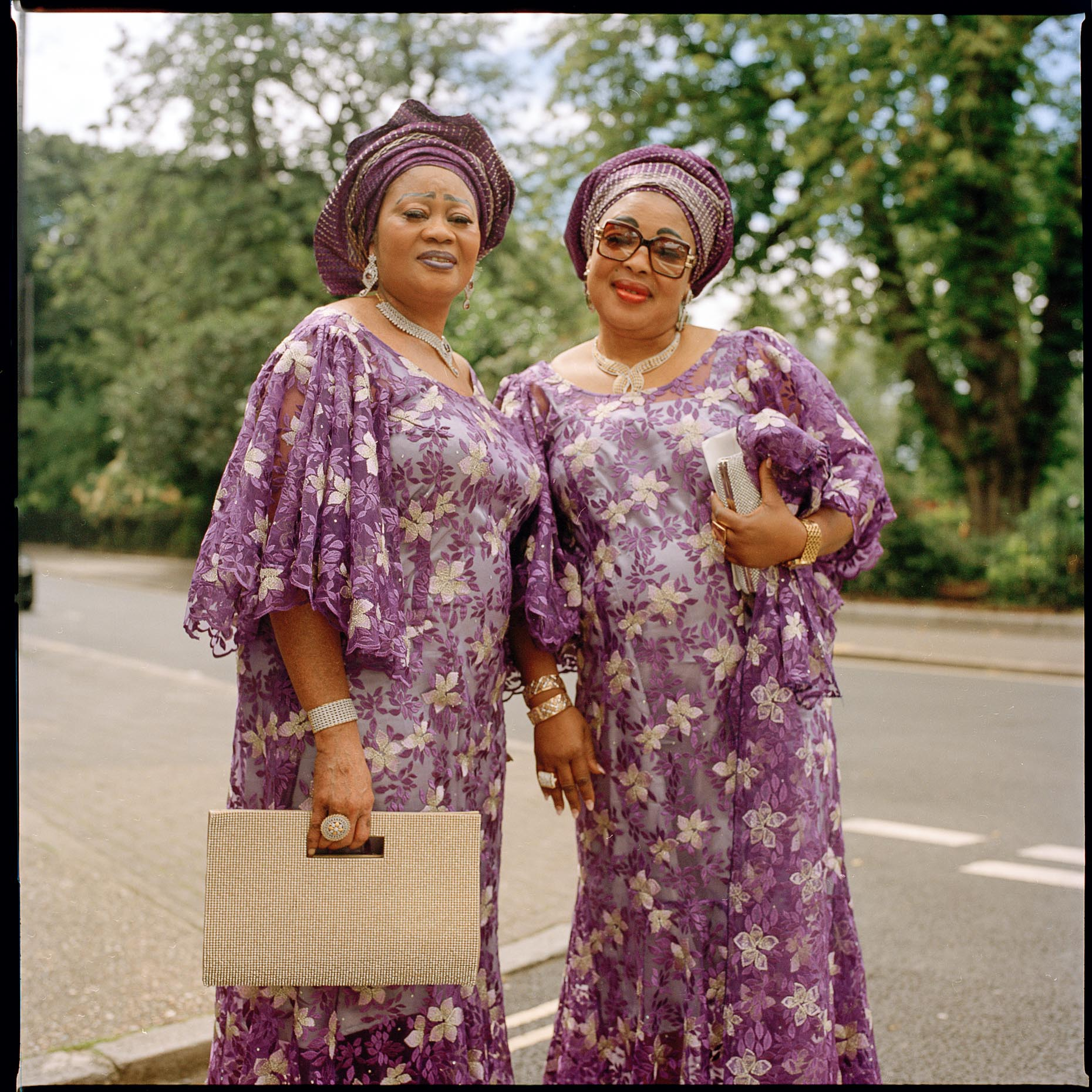 Two Ghanian ladies on their way to a wedding , Clissold Park in  Stoke Newington London.