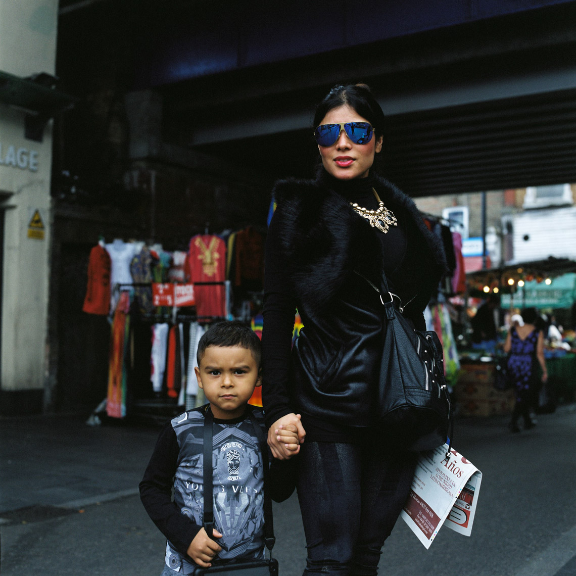 a Mother and her child pose for portrait in Brixton, London, UK