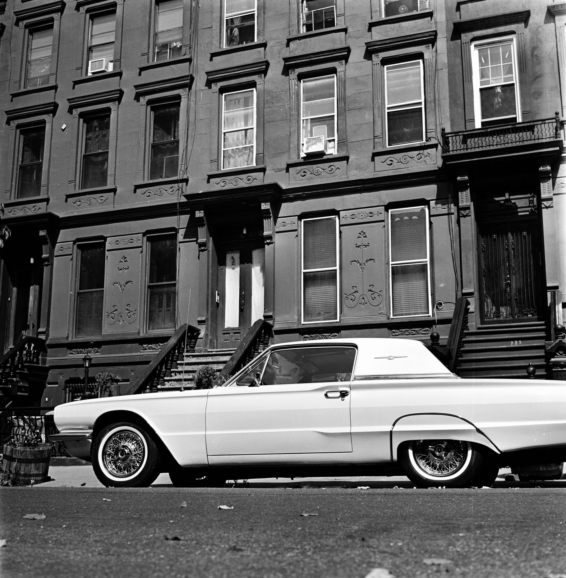 A white classic vintage Thunderbird parked on a street in Bedstuy, Brooklyn, New York