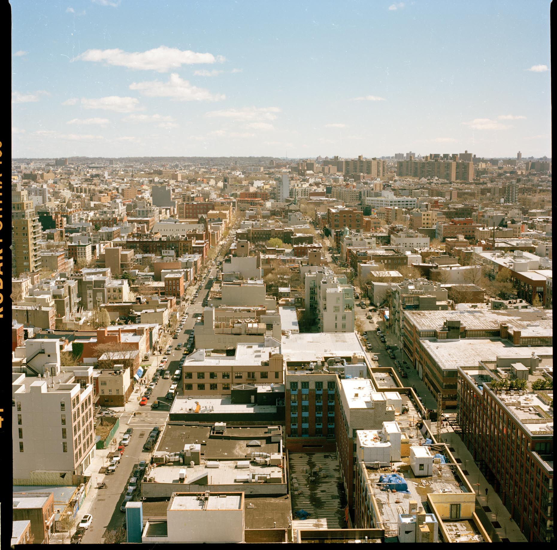 A view over Brooklyn from an apartment on Kent Avenue in Williamsburg, Brooklyn. The camera looks east towards Bushwick and beyond.