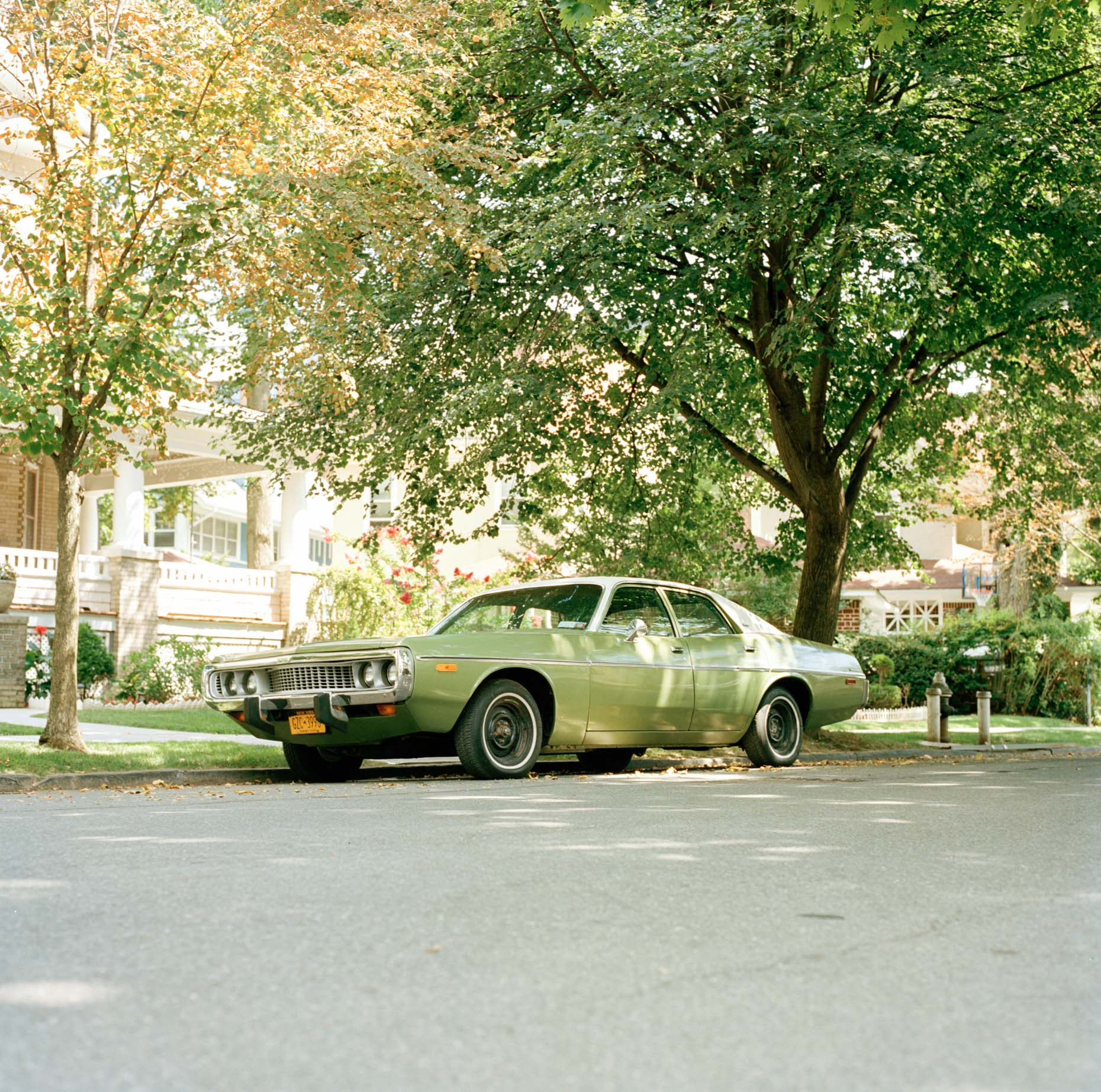 A vintage car sits in a quiet street in Ditmas Park, Brooklyn  on a July afternoon
