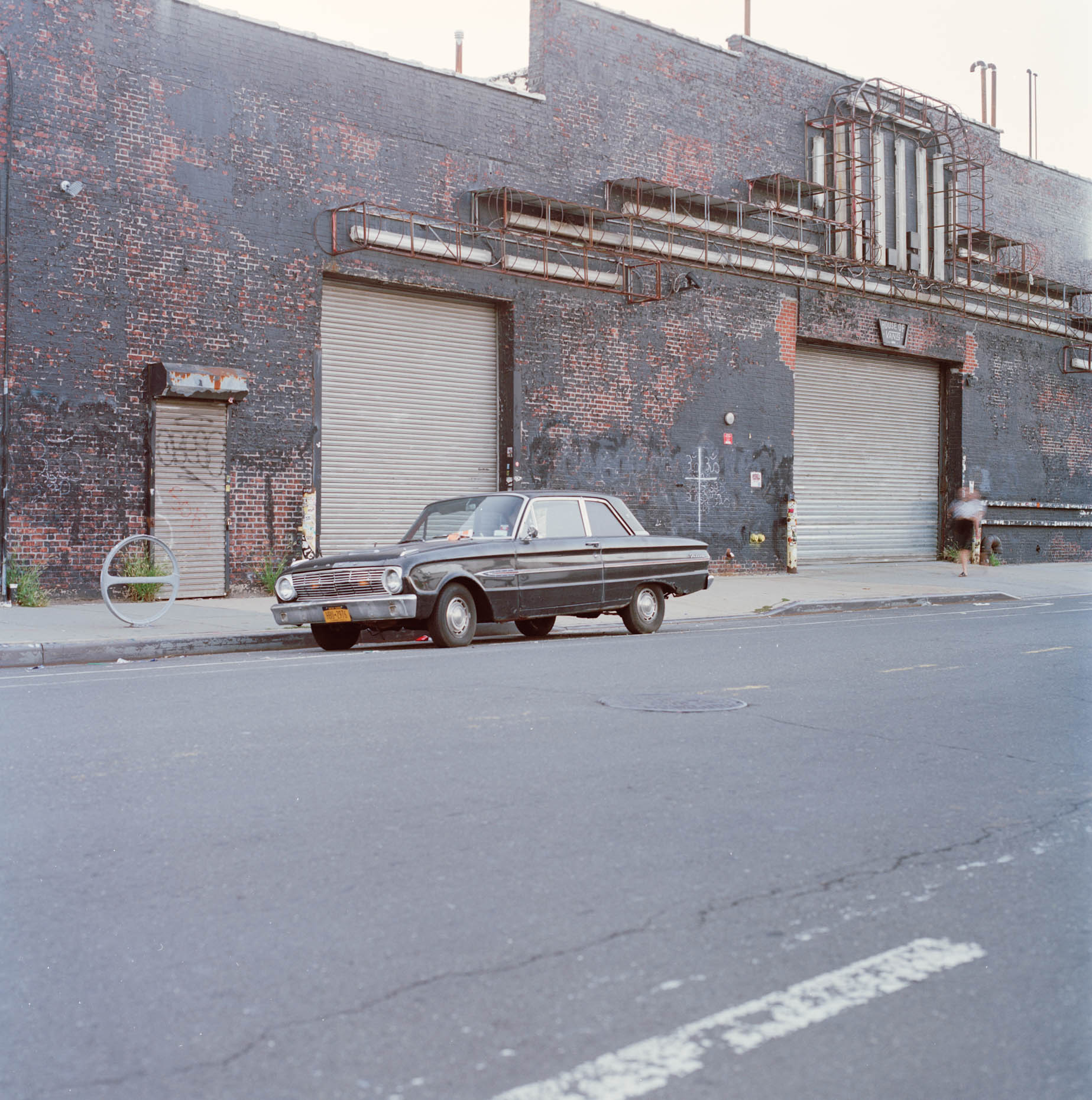 An abandoned vintage ford sits on Kent Ave  in Greenpoint, Brooklyn collecting tickets.