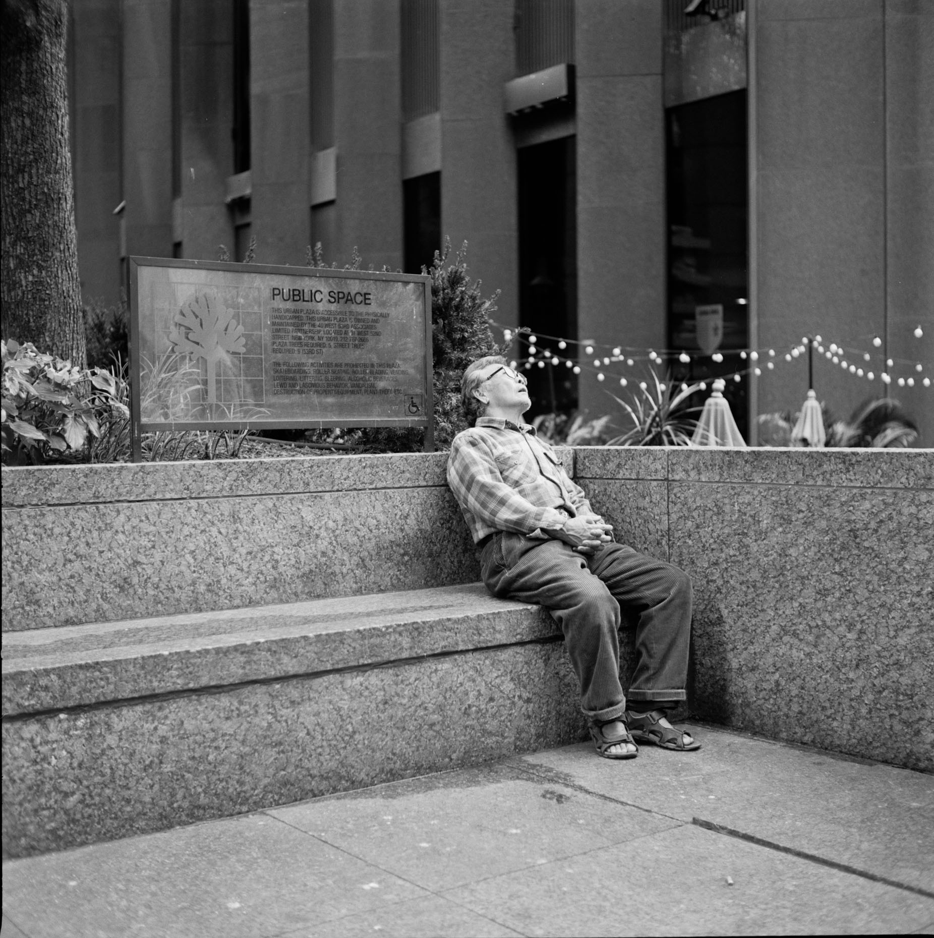 A man snoozes in Midtown Manhattan.