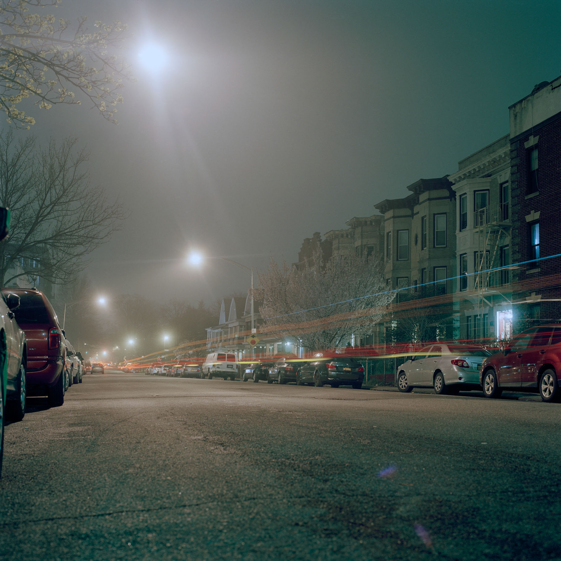 A quiet street in Ditmas Park, Brooklyn sits enveloped in mist during the late night hours.