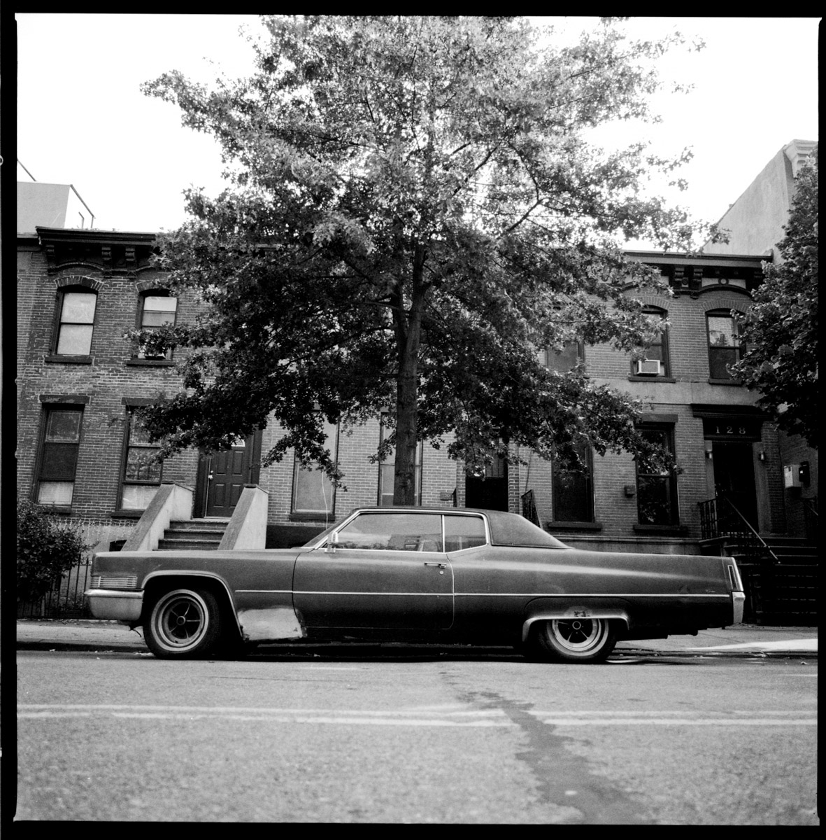 A black and white image of a car in Caroll Gardens, Brooklyn