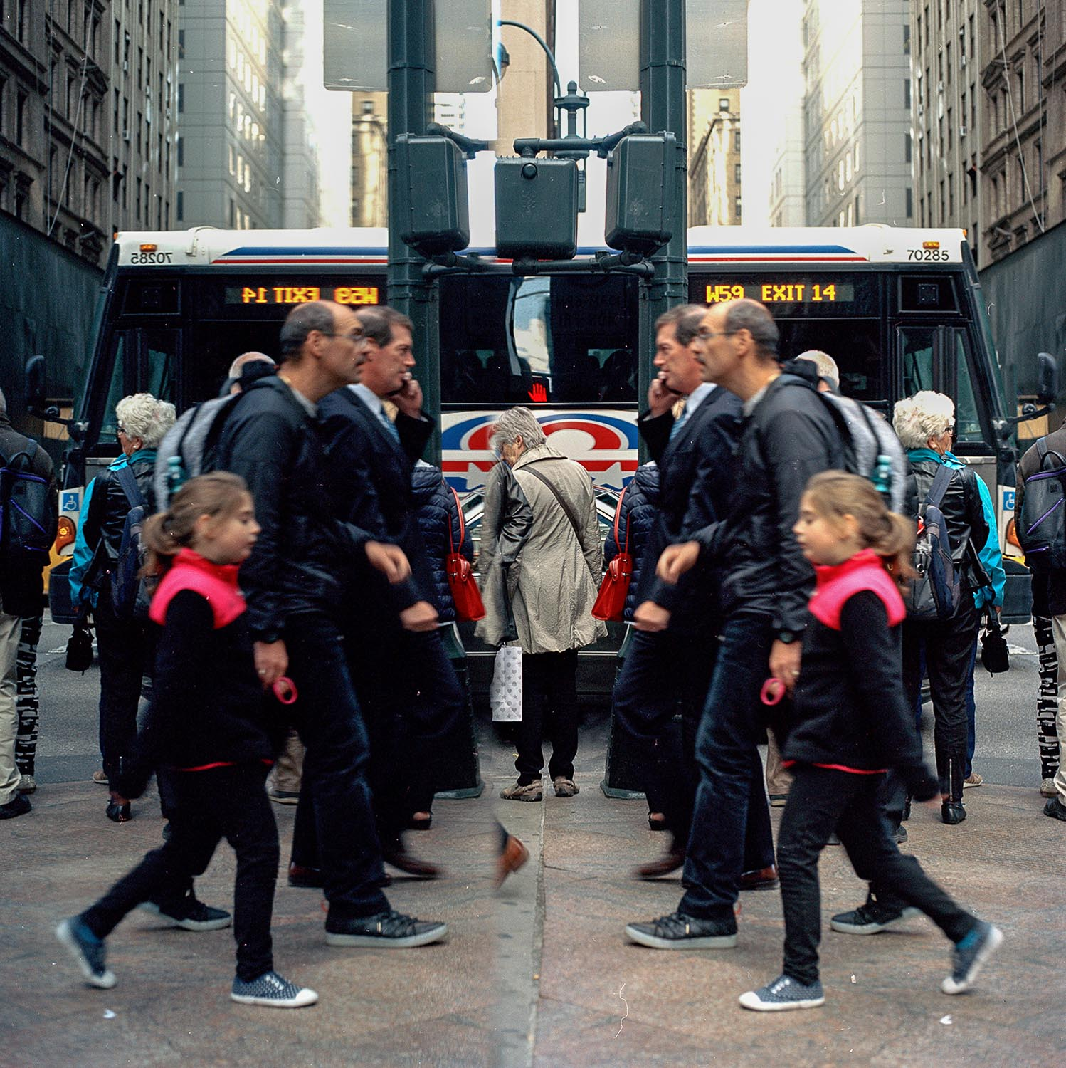 A reflection of tourists in Midtown, Manhattan, New York City.