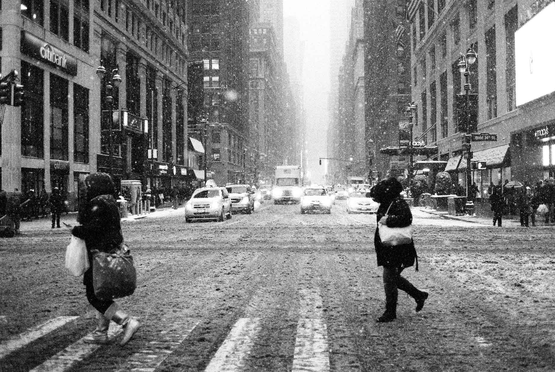 New York Commuters cross 7th ave in a blizzard in the North East of USA