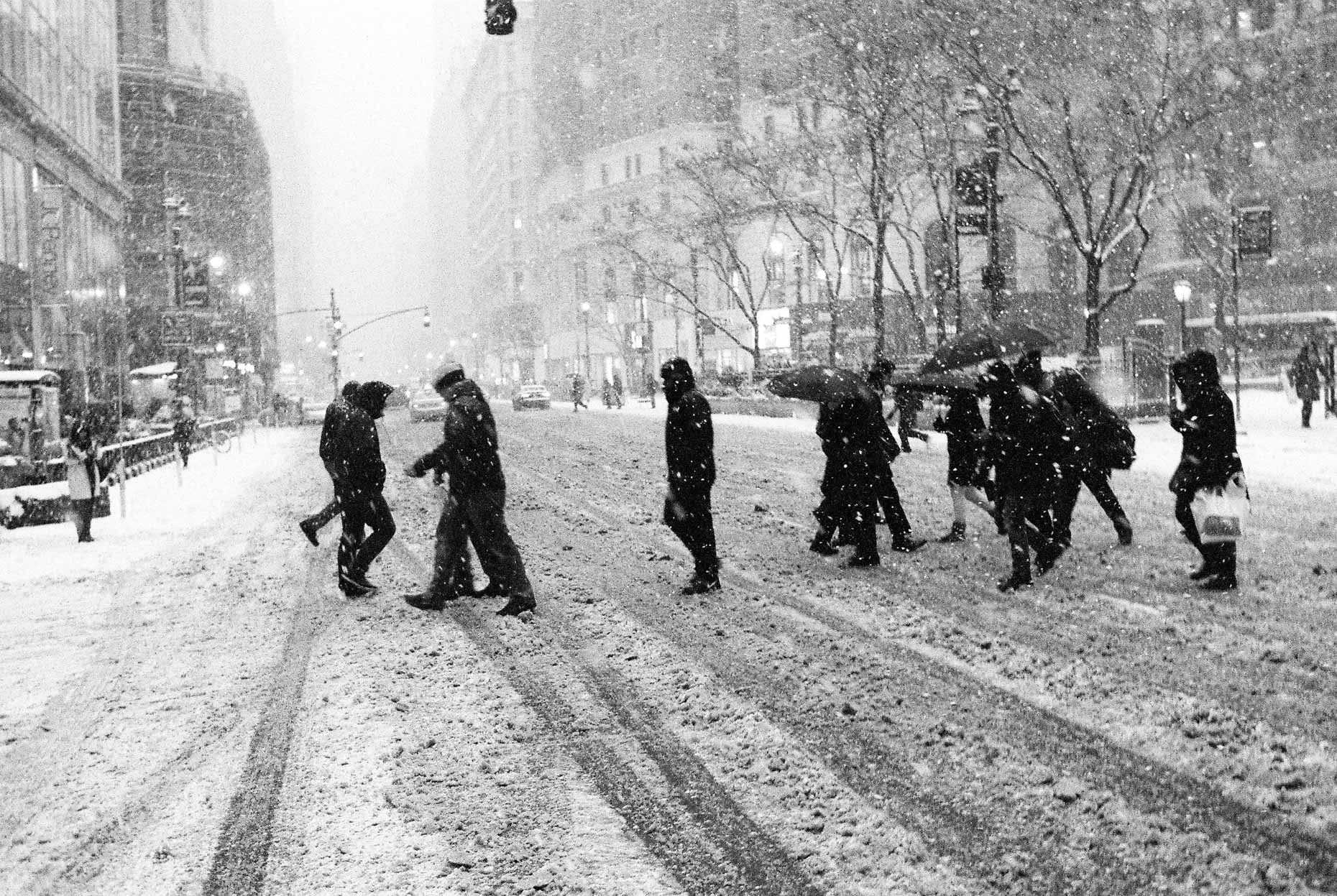 New York City Commuters cross 7th ave in a blizzard.