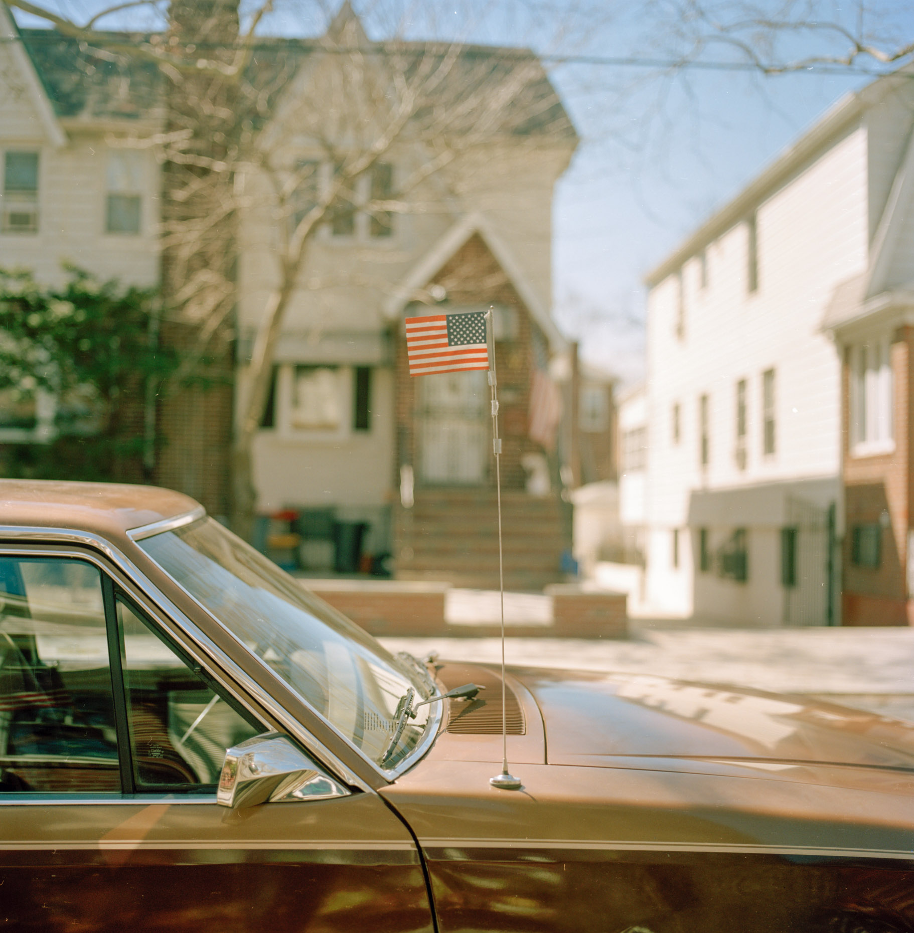 A vintage car displays an US flag in Midwood, Brooklyn.