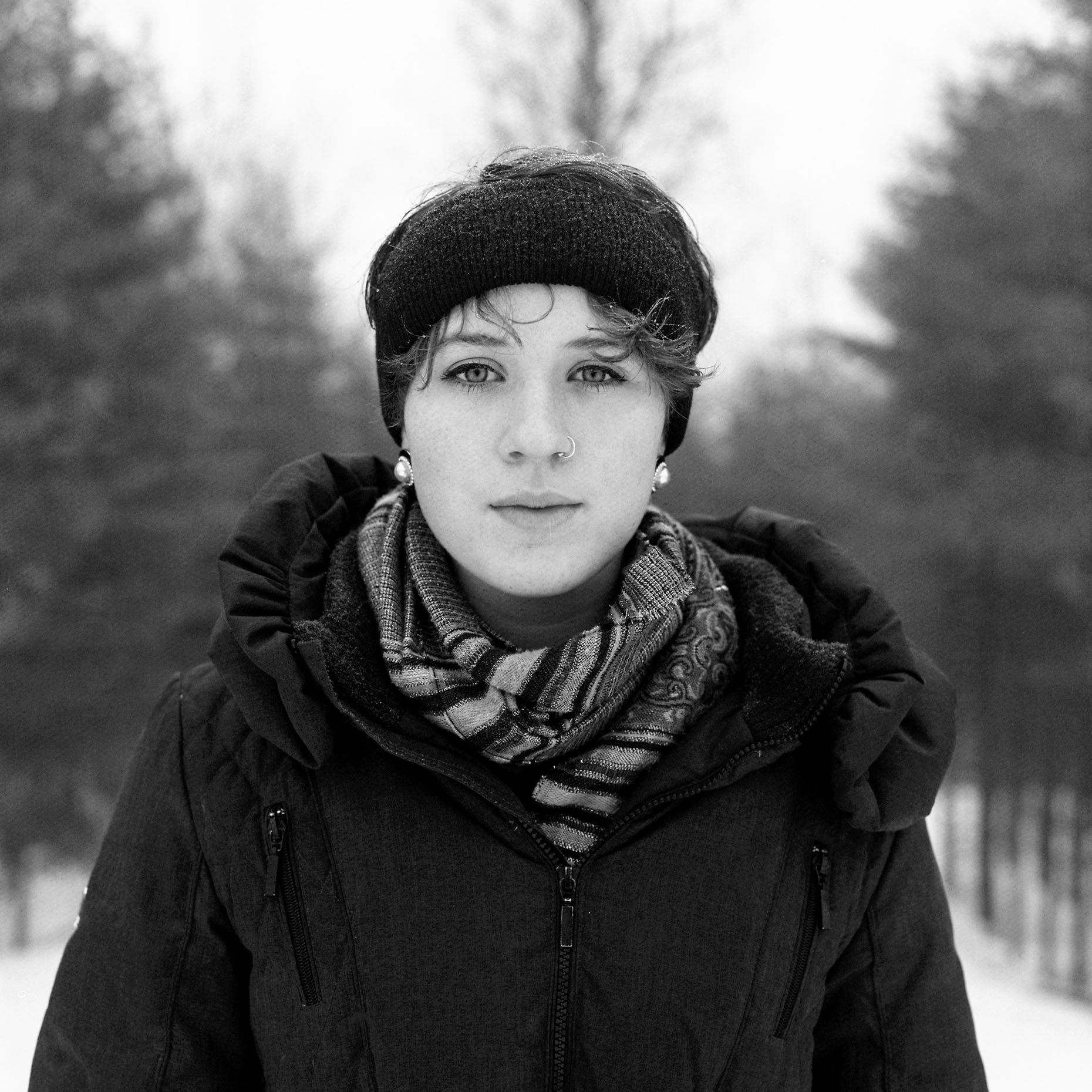 Black and White winter portrait of Bridie Kaffrisen, Canada.
